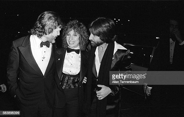 American actors Kris Kristofferson and Barbra Streisand along with producer Jon Peters arrive for the premiere of their film 'A Star Is Born' at...