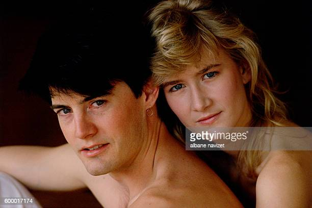 American actors Kyle MacLachlan and Laura Dern costar in the movie Blue Velvet written and directed by David Lynch
