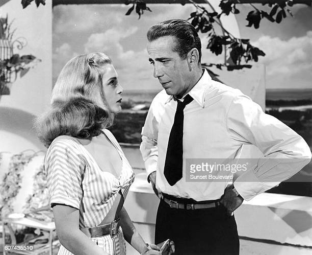 American actors Lizabeth Scott and Humphrey Bogart on the set of Dead Reckoning directed by John Cromwell