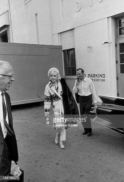 American actors Marilyn Monroe and Wally Cox leave the studio together after a day's filming on the set of 'Something's Got to Give' Los Angeles...