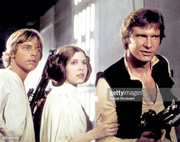 American actors Mark Hamill Carrie Fisher and Harrison Ford on the set of Star Wars Episode IV A New Hope written directed and produced by Georges...