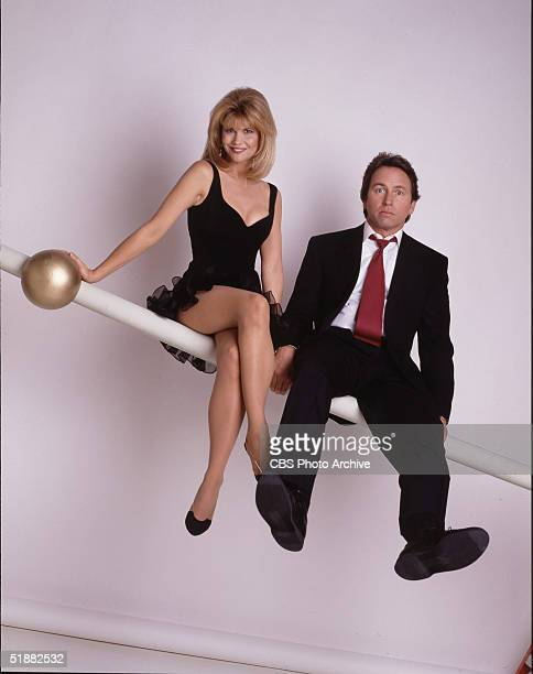American actors Markie Post John Ritter sit on a rail as they pose together in a promotional still from the television series 'Hearts Afire' 1992