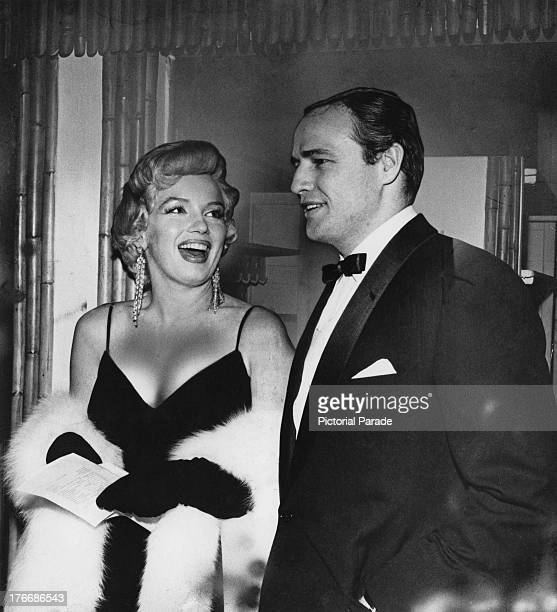 American actors Marlon Brando and Marilyn Monroe at a party in New York City 1956