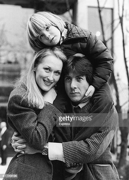 1979 American actors Meryl Streep Dustin Hoffman and Justin Henry embrace outdoors in the film 'Kramer vs Kramer' directed by Robert Benton
