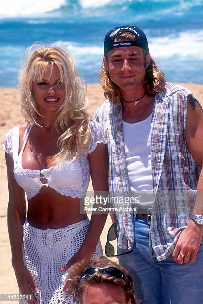 American actors Pamela Anderson and Jaason Simmons who appear in the television show 'Baywatch' promote the Coca Cola Surf Classic event at Bondi...