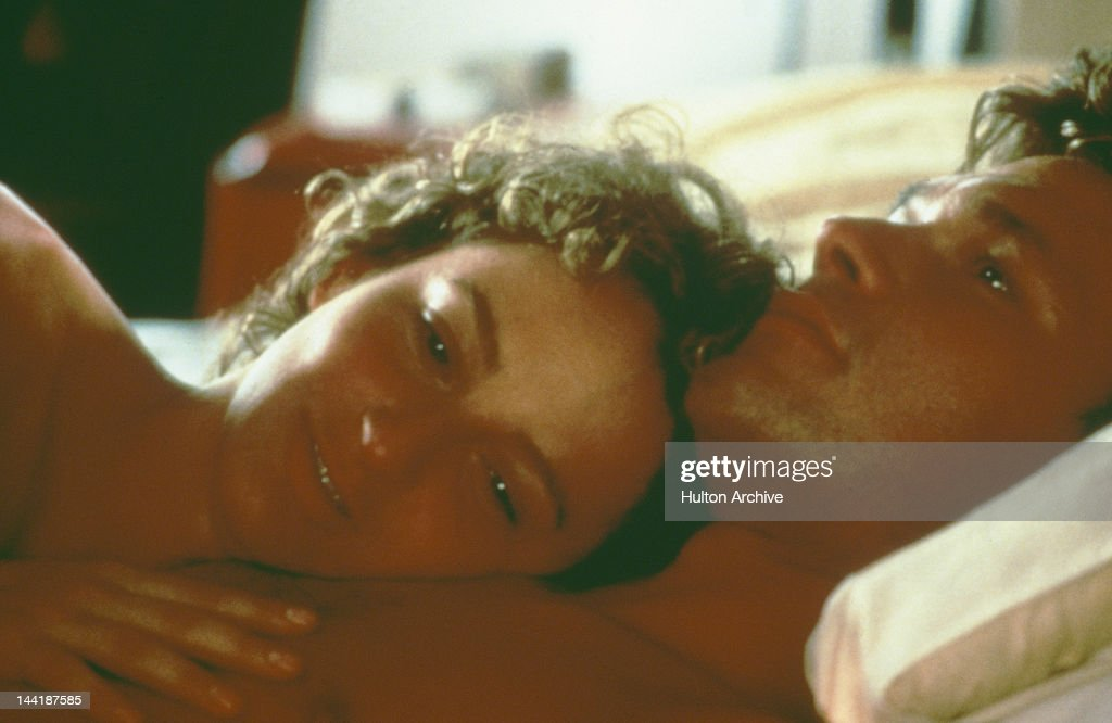 American actors Patrick Swayze (1952 - 2009) and Jennifer Grey enjoy a post-coital moment in the film 'Dirty Dancing', 1987.