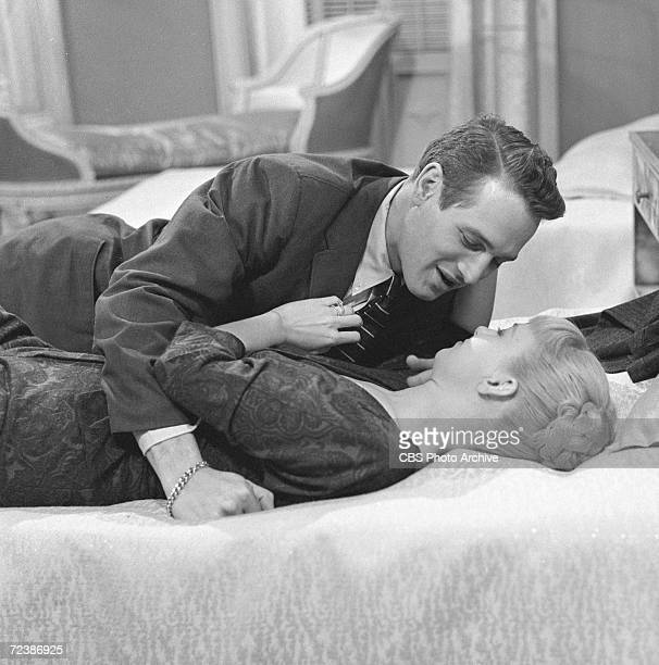 American actors Paul Newman and Joanne Woodward share an intimate moment in a scene from an episode of Playhouse 90 entitled 'EightyYard Run' January...
