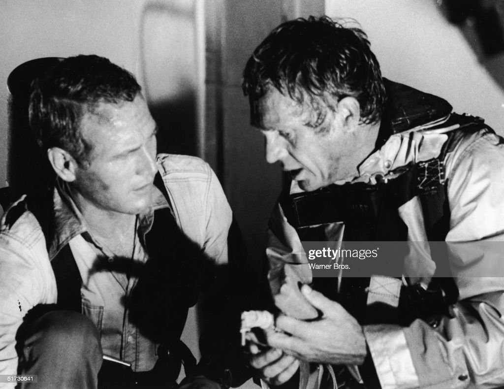 American actors Paul Newman (left) and Steve McQueen (1930 - 1980) in character as the architect Doug Roberts and the fire chief Michael O'Hallorhan respectively in a still from the epic disaster film 'The Towering Inferno' directed by Irwin Allen and John Guillermin, 1974.