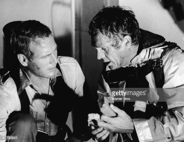 American actors Paul Newman and Steve McQueen in character as the architect Doug Roberts and the fire chief Michael O'Hallorhan respectively in a...