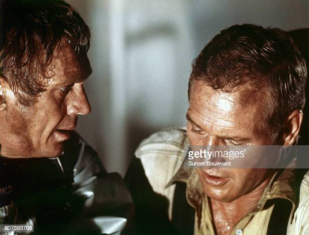American actors Paul Newman and Steve McQueen on the set of The Towering Inferno based on the novel by Richard Martin Stern and directed by John...