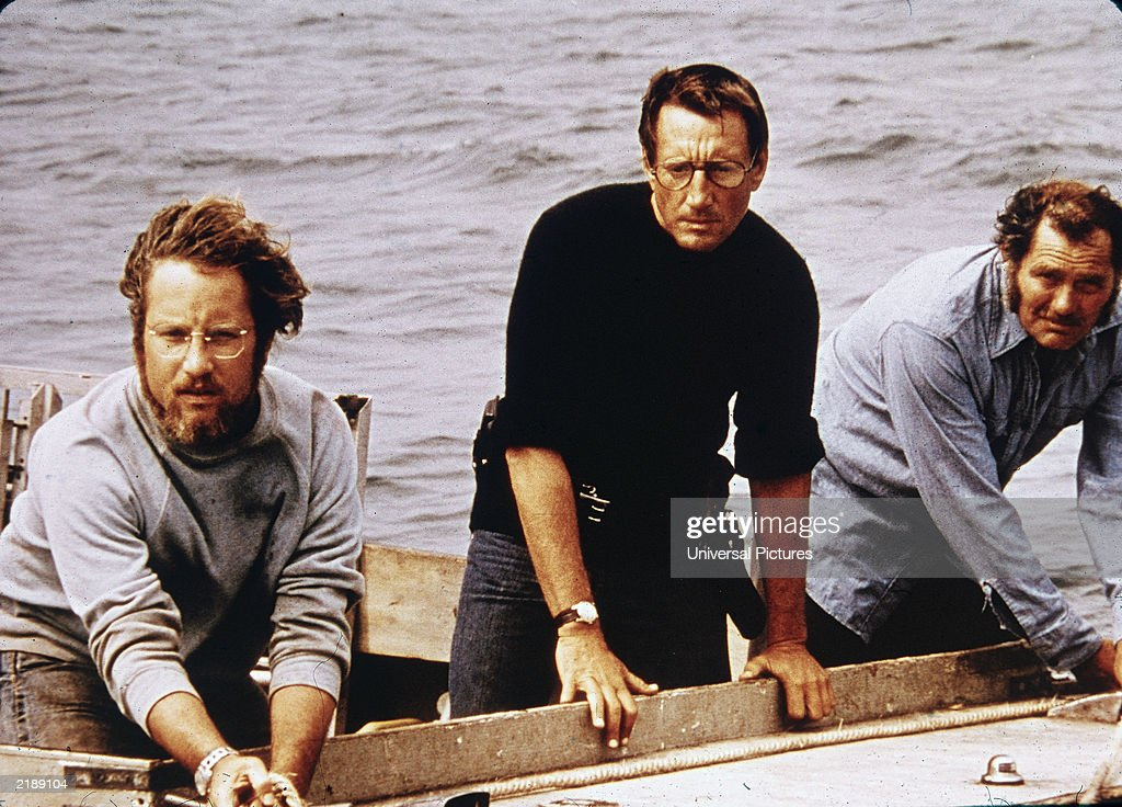 American actors Richard Dreyfuss, Roy Scheider and Robert Shaw on board a boat in a still from the film, 'Jaws,' directed by Steven Spielberg, 1975.