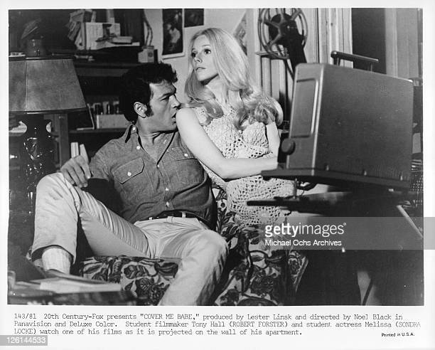 Robert Forster and Sondra Locke watch one of his films in apartment in a scene from the film 'Cover Me Babe' 1970 Photo by 20th CenturyFox/Getty...