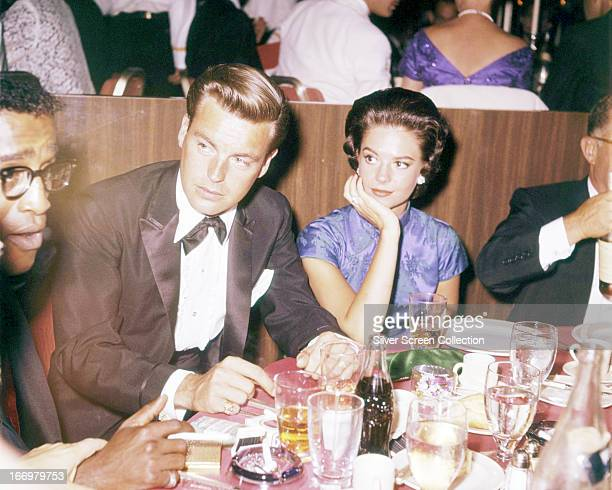 American actors Robert Wagner and Natalie Wood at a restaurant circa 1958 On the far left is Sammy Davis Jnr