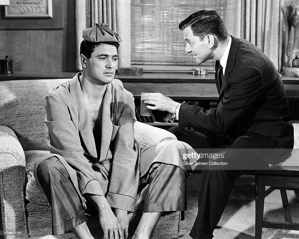 American actors <a gi-track='captionPersonalityLinkClicked' href=/galleries/search?phrase=Rock+Hudson&family=editorial&specificpeople=94007 ng-click='$event.stopPropagation()'>Rock Hudson</a> (1925 - 1985, left), as Brad Allen, and <a gi-track='captionPersonalityLinkClicked' href=/galleries/search?phrase=Tony+Randall+-+Actor&family=editorial&specificpeople=167042 ng-click='$event.stopPropagation()'>Tony Randall</a> (1920 - 2004) as Jonathan Forbes in 'Pillow Talk', directed by Michael Gordon, 1959.
