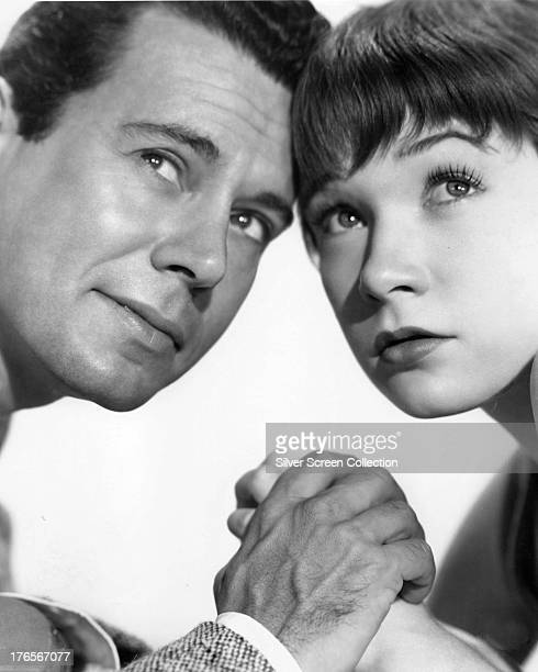 American actors Shirley MacLaine and John Forsythe in a promotional portrait for 'The Trouble With Harry' directed by Alfred Hitchcock 1955