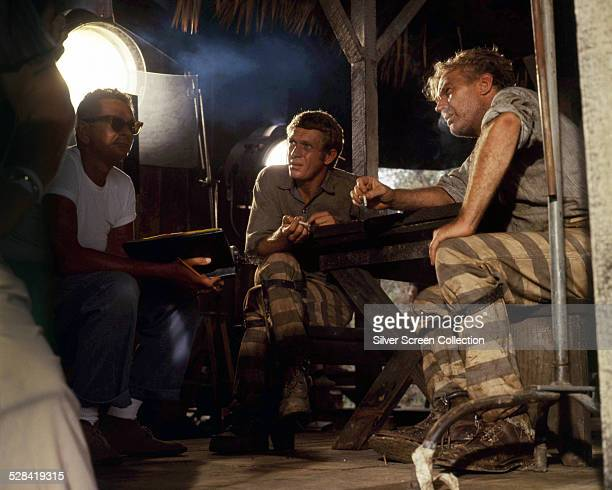 American actors Steve McQueen and Arthur Kennedy on the set of 'Nevada Smith' directed by Henry Hathaway 1966 The man on the left may be...