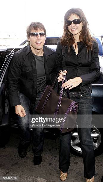 American actors Tom Cruise and his fiance Katie Holmes arrive at the Gare de Lyon train station before leaving for Marseille ahead of the French...