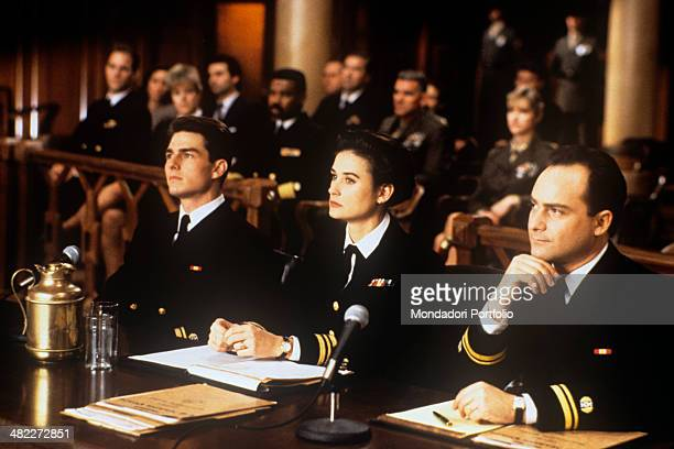 American actors Tom Cruise Demi Moore and Kevin Pollack attending a trial in the film A Few Good Men 1992