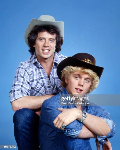 American actors Tom Wopat and John Schneider in a promotional portrait for the TV show 'The Dukes of Hazzard' circa 1980 They play Luke and Bo Duke...