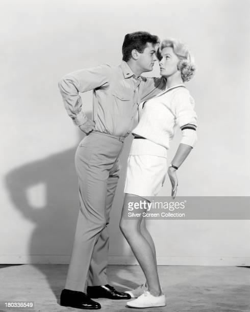 American actors Tony Curtis and Dina Merrill in a promotional portrait for 'Operation Petticoat' directed by Blake Edwards 1959