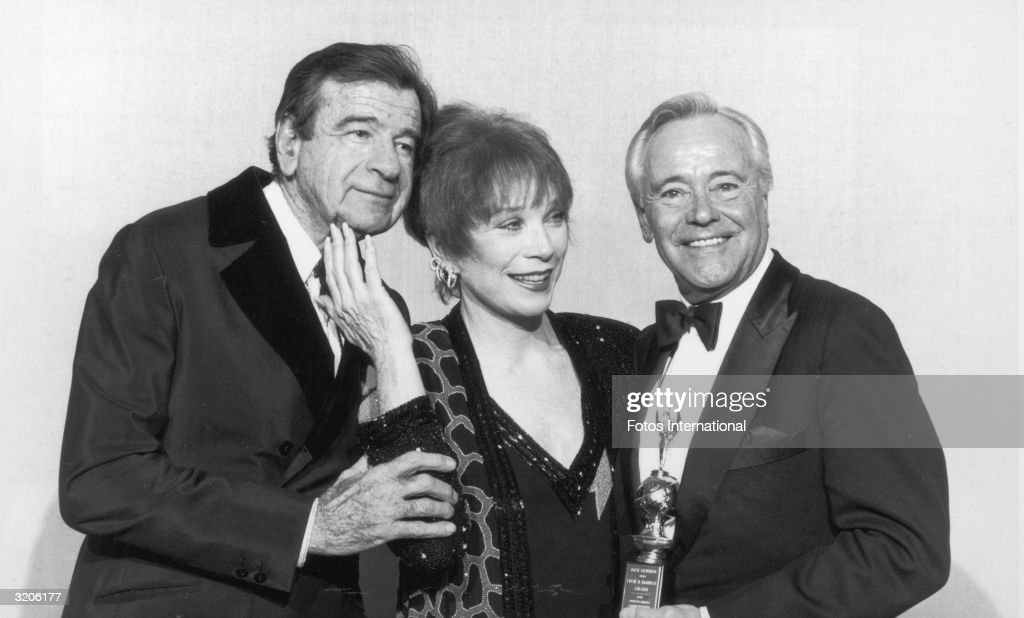 American actors Walter Matthau (1920 - 2000; left), <a gi-track='captionPersonalityLinkClicked' href=/galleries/search?phrase=Shirley+MacLaine&family=editorial&specificpeople=204788 ng-click='$event.stopPropagation()'>Shirley MacLaine</a> and Jack Lemmon (1925 - 2001) pose backstage at the Golden Globes, Los Angeles, California. Lemmon holds his Cecil B. DeMille Award, which he received for Lifetime Achievement.