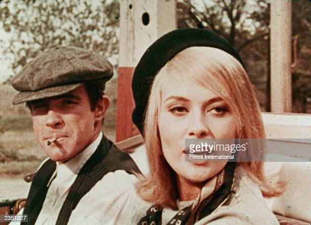 American actors Warren Beatty and Faye Dunaway sit in a car in a still from the film 'Bonnie And Clyde' directed by Arthur Penn 1967