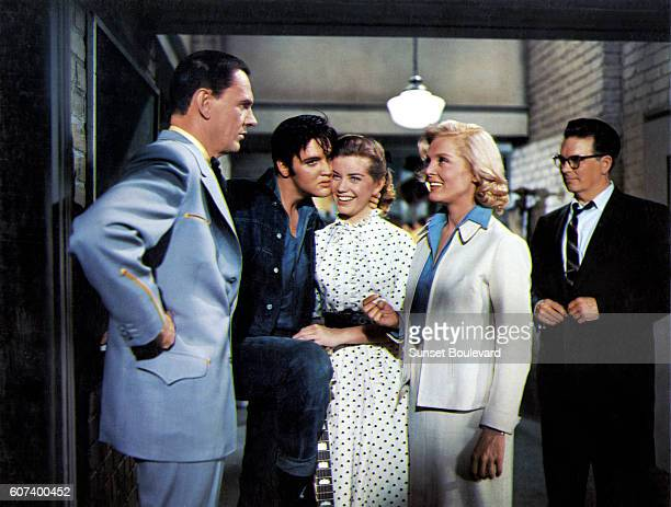 American actors Wendell Corey Elvis Presley Dolores Hart and Lizabeth Scott on the set of Loving You written and directed by Hal Kanter