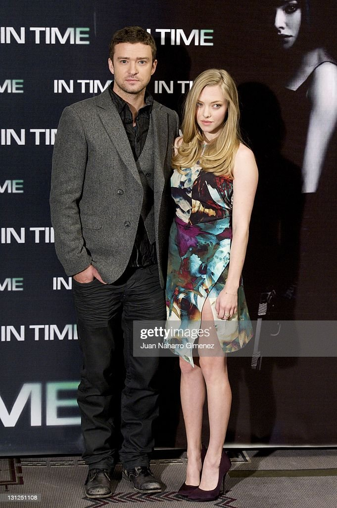 American actress <a gi-track='captionPersonalityLinkClicked' href=/galleries/search?phrase=Amanda+Seyfried&family=editorial&specificpeople=216619 ng-click='$event.stopPropagation()'>Amanda Seyfried</a> (R) and American actor <a gi-track='captionPersonalityLinkClicked' href=/galleries/search?phrase=Justin+Timberlake&family=editorial&specificpeople=157482 ng-click='$event.stopPropagation()'>Justin Timberlake</a> (L) attend 'In Time' photocall at Villa Magna Hotel on November 3, 2011 in Madrid, Spain.