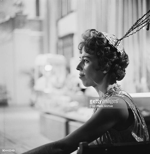 American actress and commedienne Carol Burnett sits on the set for an episode of the television show 'The Twilight Zone' entitled 'Cavender is...