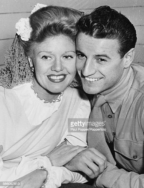 American actress and dancer Ginger Rogers and her husband Marine Private Jack Briggs pictured together following their brief honeymoon in Beverly...