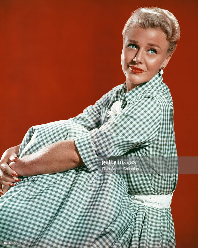 American actress and dancer <a gi-track='captionPersonalityLinkClicked' href=/galleries/search?phrase=Ginger+Rogers&family=editorial&specificpeople=93466 ng-click='$event.stopPropagation()'>Ginger Rogers</a> (1911 - 1995) in a blue gingham dress, circa 1950.