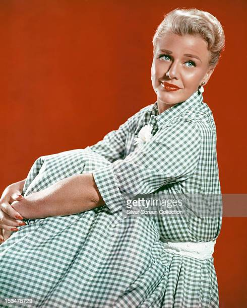 American actress and dancer Ginger Rogers in a blue gingham dress circa 1950