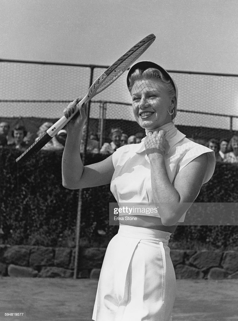 American actress and dancer <a gi-track='captionPersonalityLinkClicked' href=/galleries/search?phrase=Ginger+Rogers&family=editorial&specificpeople=93466 ng-click='$event.stopPropagation()'>Ginger Rogers</a> (1911 - 1995) playing tennis in Forest Hills, USA, circa 1950.