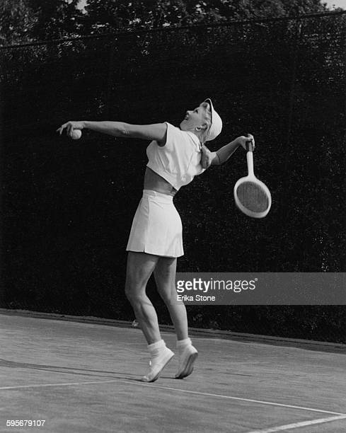 American actress and dancer Ginger Rogers playing tennis in Forest Hills USA circa 1950