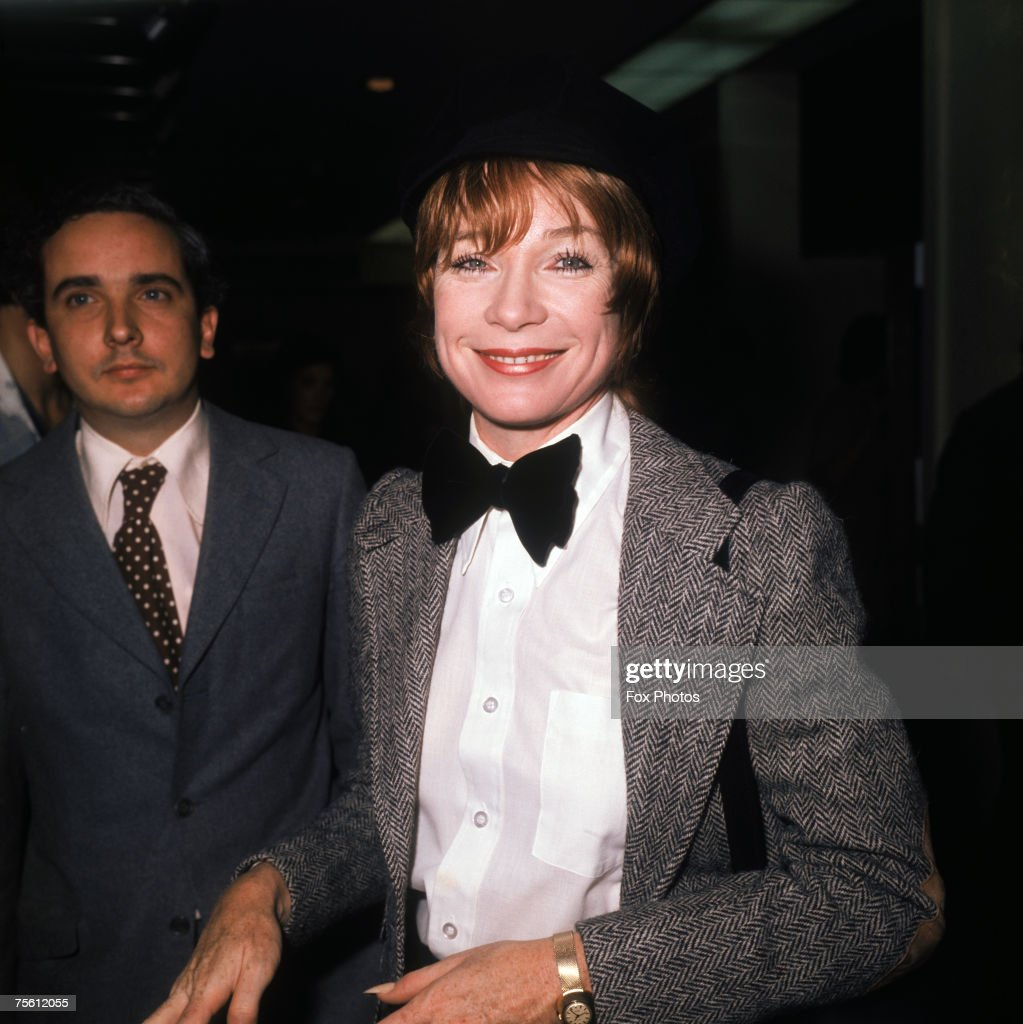 American actress and dancer Shirley Maclaine in a herringbone jacket and bow tie, circa 1980.