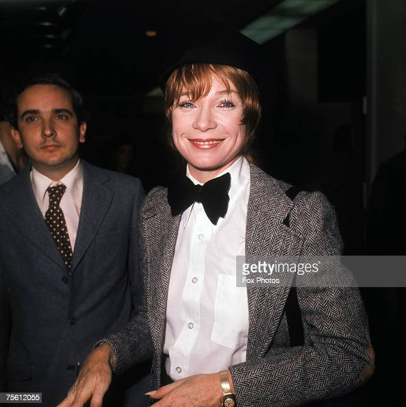 American actress and dancer Shirley Maclaine in a herringbone jacket and bow tie circa 1980