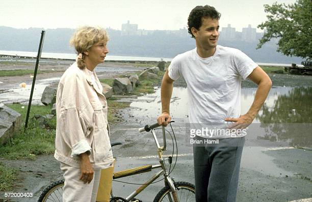 American actress and director Penny Marshall and actor Tom Hanks discuss a scene while on location for their film 'Big' 1988