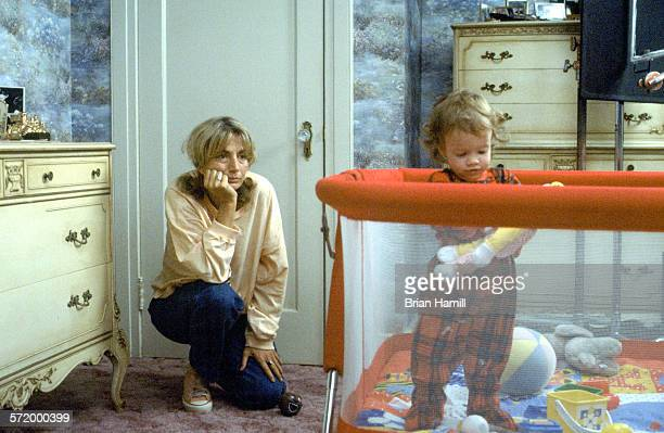 American actress and director Penny Marshall with an unidentified child actor on the set of her film 'Big' 1988