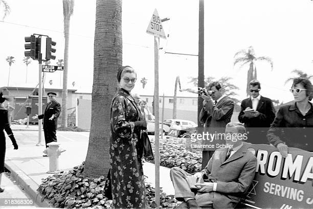 American actress and former Olympic swimmer Esther Williams stands near a bus stop after a memorial service for producer Mike Todd at Temple Israel...