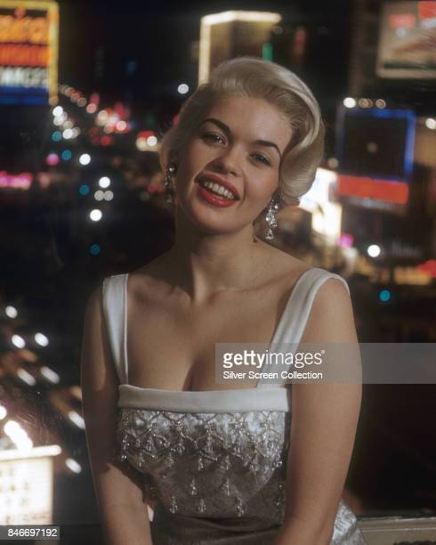 American actress and former Playboy playmate Jayne Mansfield wearing a white evening gown circa 1960