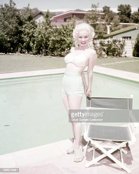 American actress and model Mamie Van Doren by a swimming pool circa 1955