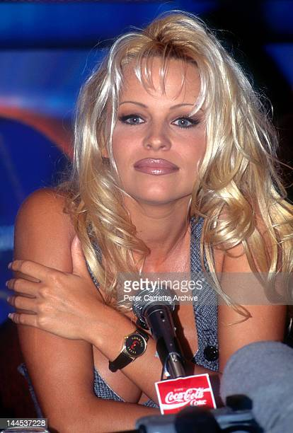 American actress and model Pamela Anderson who appears in the television show 'Baywatch' attends a press conference in December 1994 in Sydney...