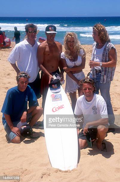 American actress and model Pamela Anderson with costars Jaason Simmons and Kelly Slater who appear in the television show 'Baywatch' promote the Coca...