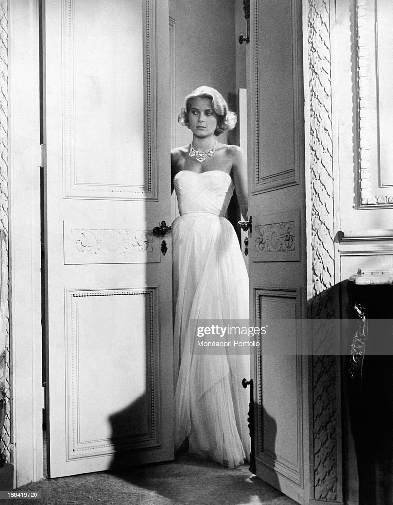 American actress and Princess consort of Monaco Grace Kelly wearing an evening dress in the film To Catch a Thief USA 1955
