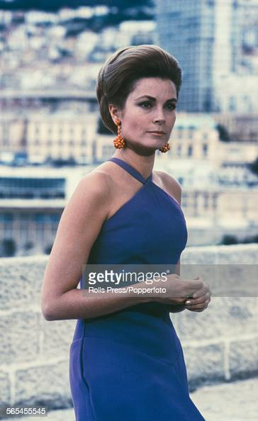 American actress and Princess of Monaco Grace Kelly pictured wearing a blue evening dress with halterneck in Monte Carlo circa 1968