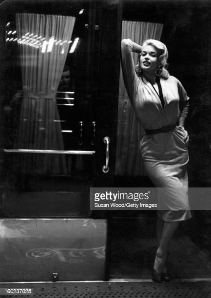 American actress and sex symbol Jayne Mansfield poses in the doorway of Sardi's restaurant New York New York late 1955