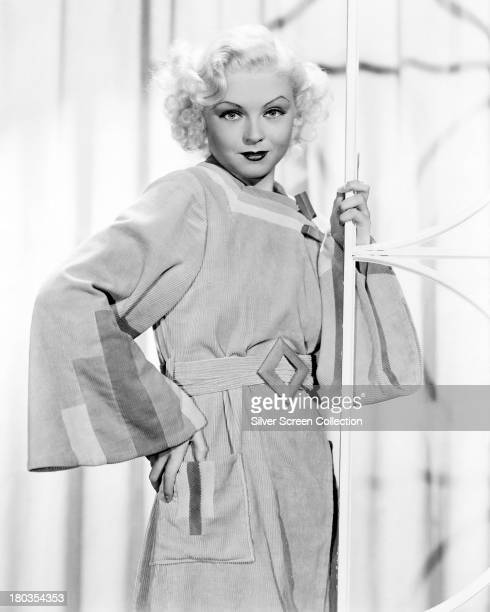 American actress and showgirl Toby Wing wearing a long gown with patchwork trim circa 1935