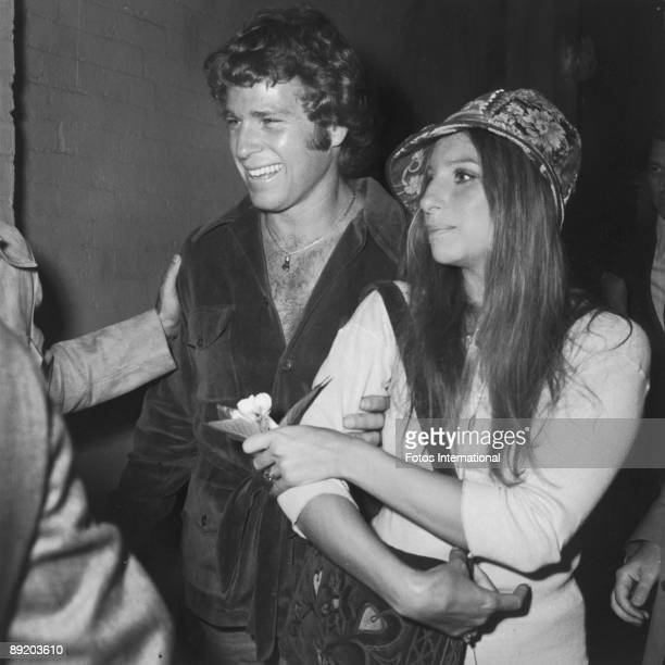 American actress and singer Barbra Streisand with actor Ryan O'Neal at a screening of the film 'Wild Rovers' in which O'Neal stars June 1971