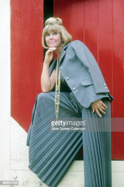 American actress and singer Doris Day wearing wide pleated trousers and a matching jacket circa 1960