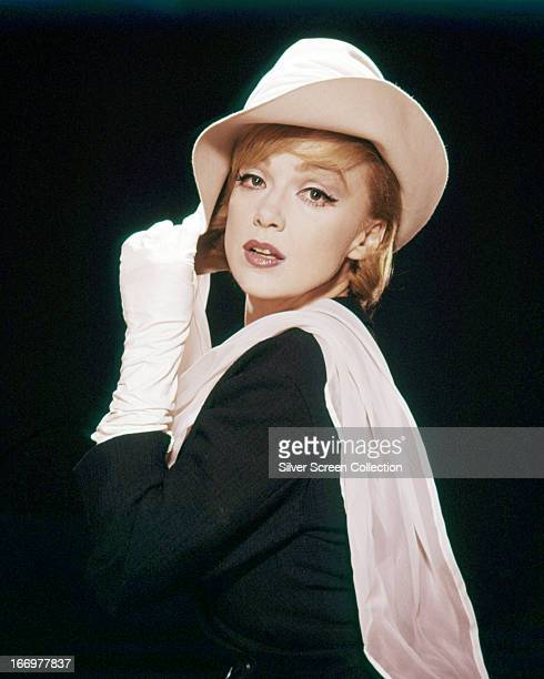 American actress and singer Edie Adams wearing a white hat scarf and gloves circa 1955